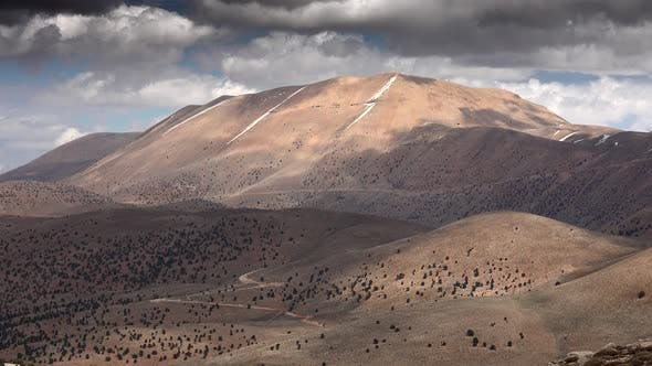 Cloud Shadows on Sparse Arid and Barren Mountain Slope