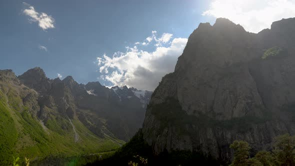 Thumbnail for View of High Rocky Mountains with Clouds in the Sky. Timelapse.