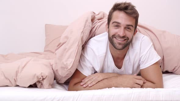 Thumbnail for Fun Guy Appearing From Under Duvet