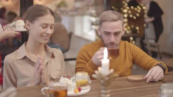 Young Man and Woman in Restaurant