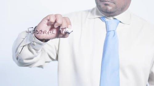 Latino Businessman Writes Federal Taxes