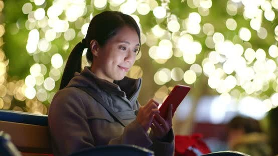 Thumbnail for Woman use of cellphone with Christmas decoration