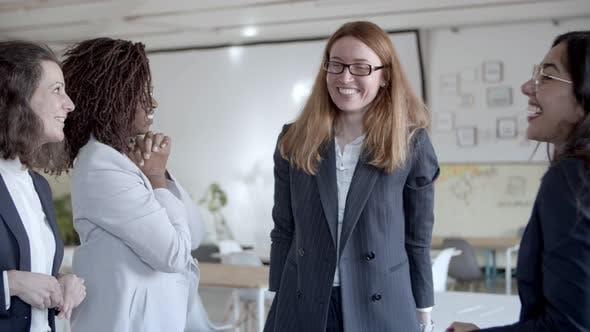 Happy Businesswomen Triumphing in Office