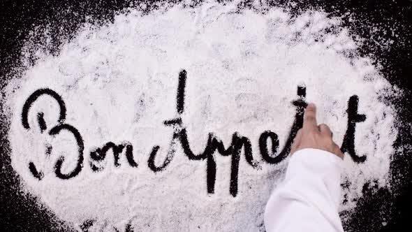 Thumbnail for Salt Writing on Black Surface  Bon Appetit