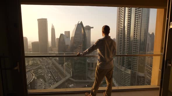 Thumbnail for Young Business Man Succeed in Finance Career Standing on Modern Office Cityscape Balcony