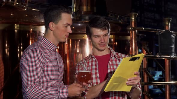 Thumbnail for Two Brewers Examining Craft Beer, Working at the Brewery