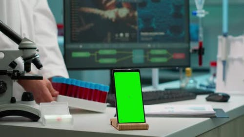 Smartphone Working in Laboratory with Chroma Key Display