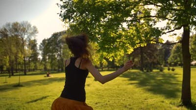 Young Attractive Woman Run with Happiness in Park