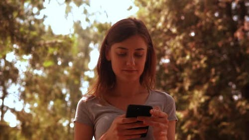 Portrait Young Woman Holding Mobile Phone