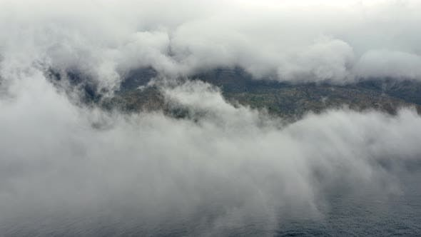 Thumbnail for Lush Green Mountains and the Beach Beneath Thick Fog
