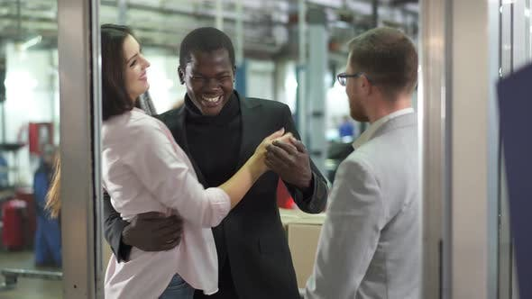 Thumbnail for Positive Biracial Family Hugging in Car Dealership