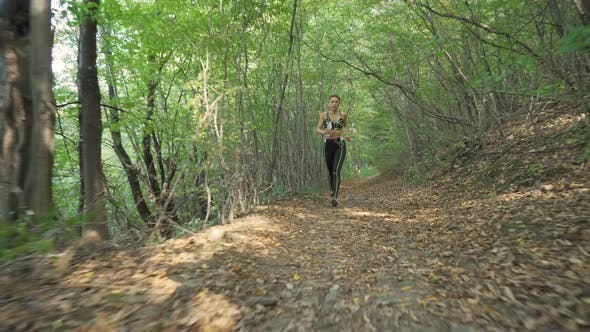 Thumbnail for Sporty Girl Sprinting on Forest Path