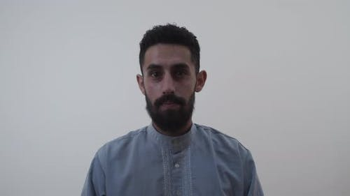 Middle eastern man looking at the camera