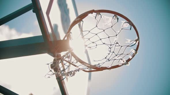 Thumbnail for A Basketball Hoop. A Ball Gets in the Target. Bright Sunlight