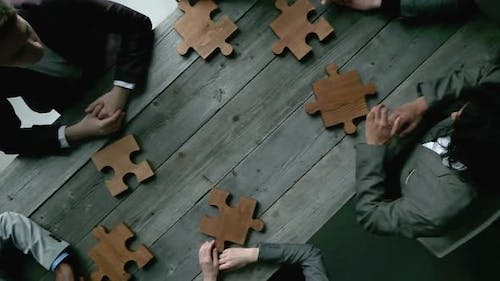 Business teamwork with puzzle