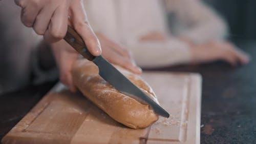 Cutting Fresh Loaf Of Bread