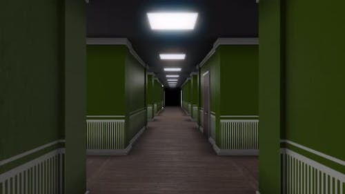 Moving through the corridor inside the hotel building with green walls