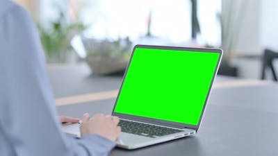 Latin Woman Using Laptop with Green Chroma Key Screen