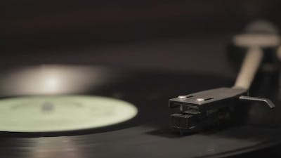 Detail of vintage record player with spinning vinyl. Shallow focus