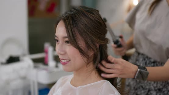 Thumbnail for Stylist makes hair for bride