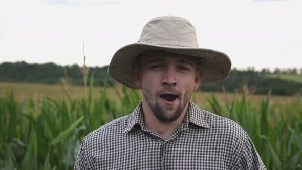Thumbnail for Portrait of Tired Male Farmer Yawning Against the Blurred Background of Corn Field. Exhausted Sleepy