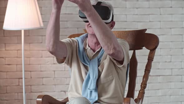 Thumbnail for Gesturing Old Man in VR Headset