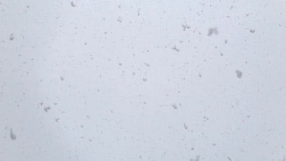 Thumbnail for Slow Motion Footage of Fresh White Snow Falling