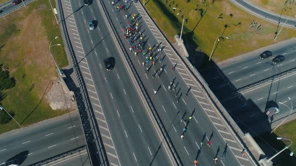 Thumbnail for Following Marathon Running Group on the Road Junction