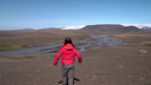 Girl in Red Clothes Travels To Iceland