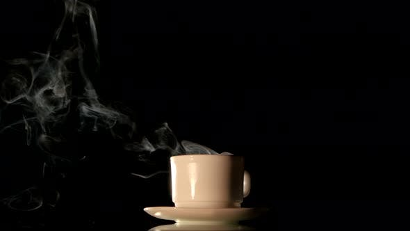 Thumbnail for Steaming White Coffee Cup on Black Background
