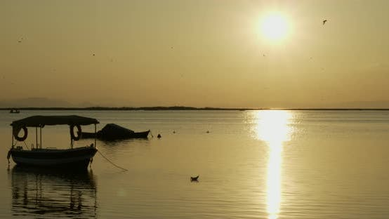 Thumbnail for Boat And Sunlight In Calm Sea