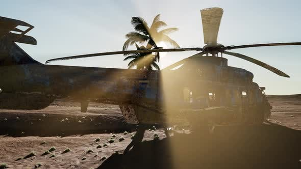 Thumbnail for Old Rusted Military Helicopter in the Desert at Sunset