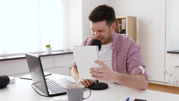 Thumbnail for Happy Young Man with Laptop and Microphone at Home