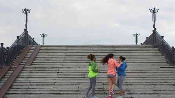 Thumbnail for Three Happy Multiethnic Women Running in City