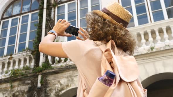 Thumbnail for Young Woman Taking Photo With Smartphone While Sightseeing In City