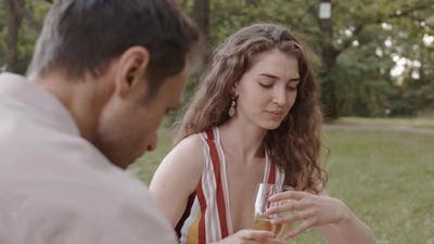 Woman Drinking Wine with Man