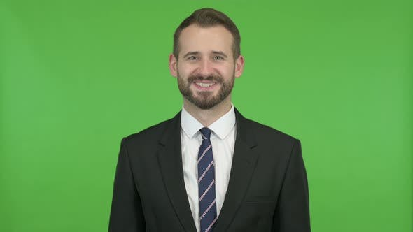 Thumbnail for Cheerful Businessman Smiling at Camera Against Chroma Key