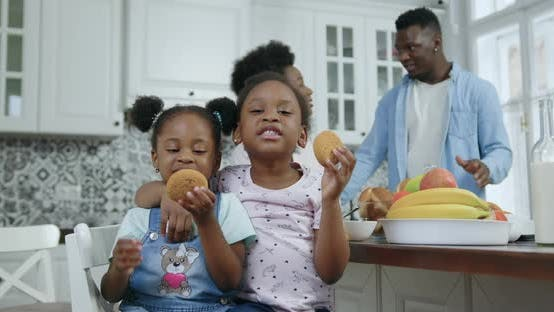 Thumbnail for Small African American Girls Pose on Camera in Contemporary Kitchen