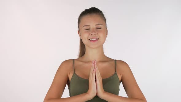 Thumbnail for Beautiful Young Woman Meditating with Eyes Closed Isolated