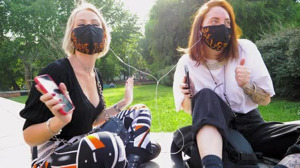Women wearing masks listening music
