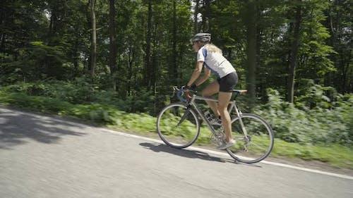 Video Woman on Racing Bike on Street