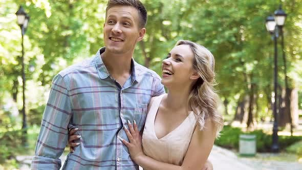 Thumbnail for Emotions of Cheerful Young Couple Enjoying Romantic Date in Summer Park, Slow-Mo