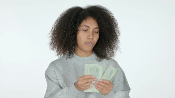 Thumbnail for African Woman Counting Dollars, White Background