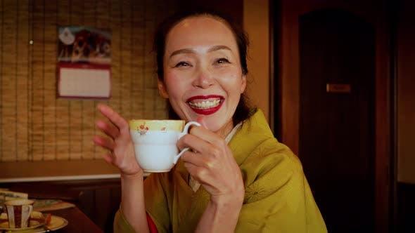 Thumbnail for Elegant Japanese woman enjoying a coffee