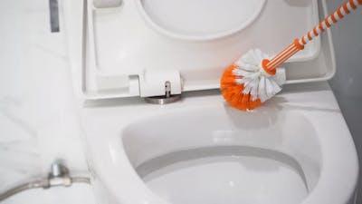 Guy Washing Toilet with Brush