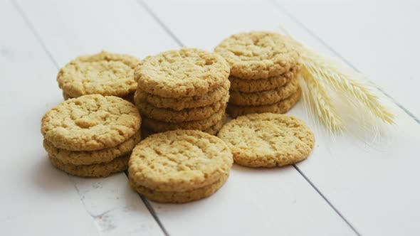 Thumbnail for Healthy Oatmeal Cookies on White Wood Background, Side View.