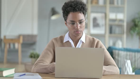 African Girl Leaving Laptop on Table After Work Done