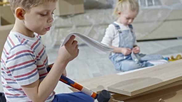 Thumbnail for Boy Reading Assembling Manual