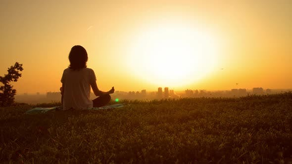 Thumbnail for Woman Sits Sundown