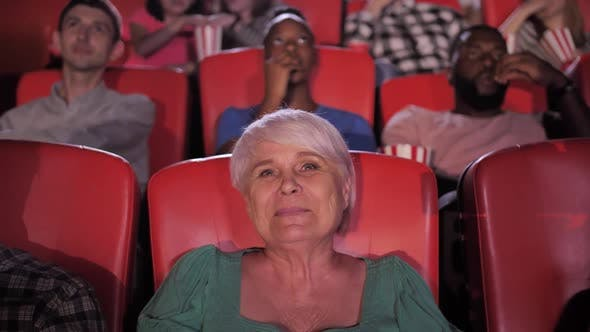 Thumbnail for Pretty Aged Woman Enjoying Movie at Cinema